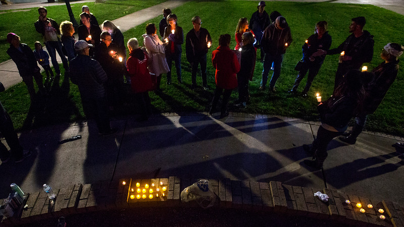 Unite Colorado Springs hosts a candlelight vigil in response to the Las Vegas mass shooting, at Acacia Park in Colorado Springs, Colo. on Tuesday, Oct. 3, 2017. About 25 people showed up in the park to listen to speakers and sing songs.
