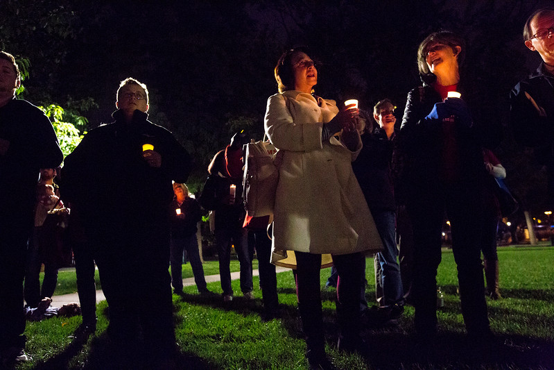 Grace Blea-Nuñez, center, and Marguerite Terze, right, lead several songs at the end of a candlelight vigil in response to the Las Vegas mass shooting, at Acacia Park in Colorado Springs, Colo. on Tuesday, Oct. 3, 2017. The vigil started with a moment of silence, then speeches and then songs.