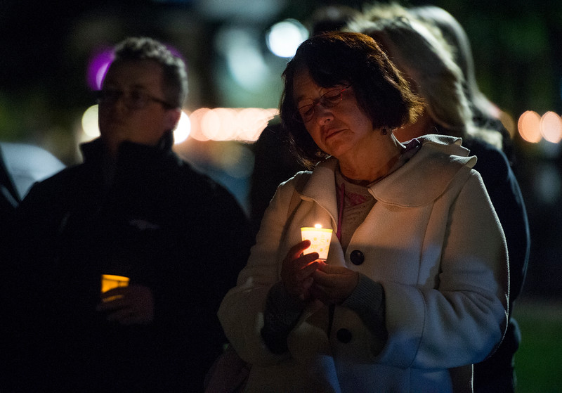 Grace Blea-Nuñez looks down at her candle at a vigil in response to the Las Vegas mass shooting, at Acacia Park in Colorado Springs, Colo. on Tuesday, Oct. 3, 2017.