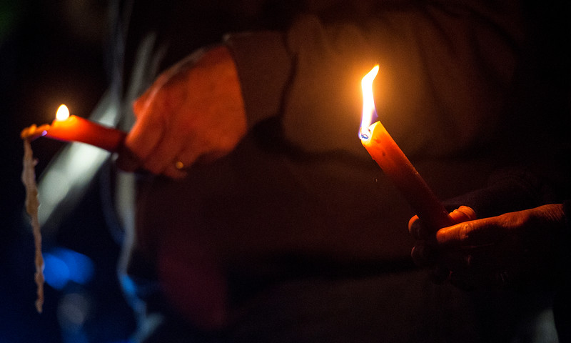 Candles slowly melt as a vigil continues for the victims of  the Las Vegas mass shooting, at Acacia Park in Colorado Springs, Colo. on Tuesday, Oct. 3, 2017. Unite Colorado Springs organized the vigil in the park.