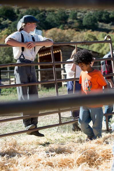 Eli Stuart waits on the rails of a fence as Fyi Earlie, 9, looks for treasure in the Candy Scramble at the Rock Ledge Ranch Harvest Festival on Saturday, Oct. 7, 2017.<br /> <br /> (The Gazette, Nadav Soroker)