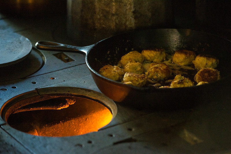 Chicken Croquets cook on an old stove in the Orchard House during the Harvest Festival at Rock Ledge Ranch on Saturday, Oct. 7, 2017.<br /> <br /> (The Gazette, Nadav Soroker)