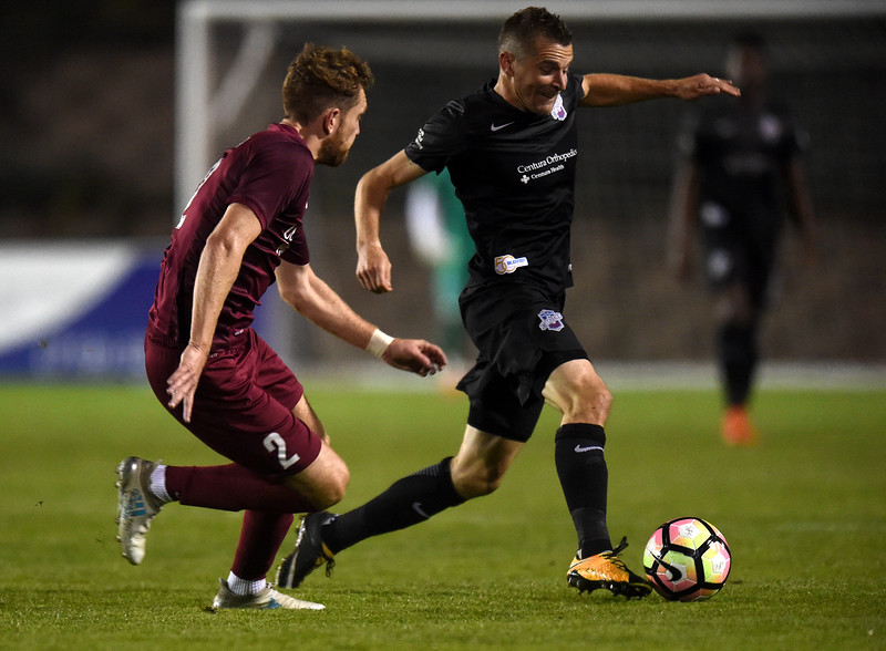 Switchbacks midfielder Luke Vercollone dribbles past Republics defender Derek Foran at Wiedner Field on Saturday, Oct. 7, 2017. The win brought the Switchbacks' record to 10 wins, 12 losses and 8 draws.<br /> <br /> (The Gazette, Nadav Soroker)