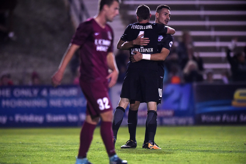 Switchbacks forward Masta Kacher hugs his teammate Luke Vercollone after defeating Sacramento Republic FC 1-0 at Wiedner Field on Saturday, Oct. 7, 2017.<br /> <br /> (The Gazette, Nadav Soroker)