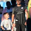 Switchbacks midfielder Tony Argueta walks onto the pitch with the captain's armband and an admirer for the opening ceremony before the match against the Sacramento Republic at Wiedner Field on Saturday, Oct. 7, 2017.<br /> <br /> (The Gazette, Nadav Soroker)