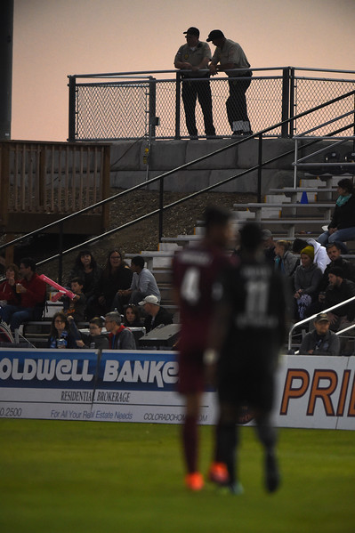 Security guards watch the Colorado Springs Switchbacks play the Sacramento Republic as the sun sets at Wiedner Field on Saturday, Oct. 7, 2017.<br /> <br /> (The Gazette, Nadav Soroker)