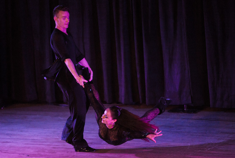 Toby Munroe swings his wife Harmony Munroe during a ballroom dance performance at Stargazers Theater on Sunday, Oct. 8, 2017.<br /> <br /> (The Gazette, Nadav Soroker)