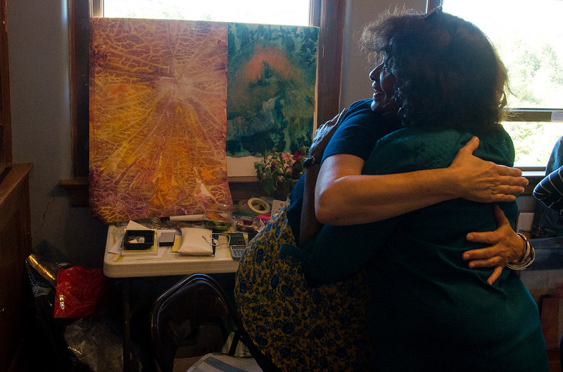 Diane Dillon hugs her friend Jill Spear in Spear's studio in the Old Midland School during the Pikes Peak Studio Tour on Sunday, Oct. 8, 2017. Spear recently resumed painting after what she called a sabbatical.<br /> <br /> (The Gazette, Nadav Soroker)