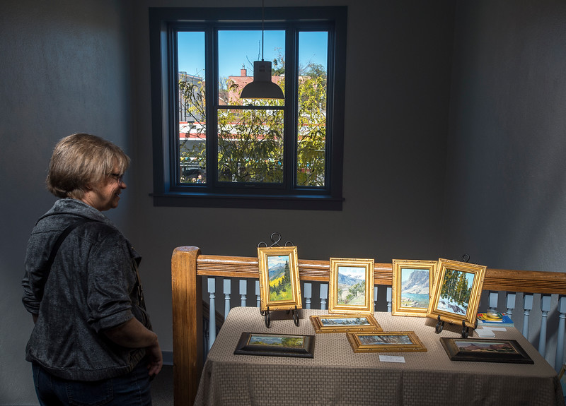 Judy Steininger looks at paintings by Tim Deibler in an open studio for the Pikes Peak Studio Tour on Sunday, Oct. 8, 2017. Steininger has done the tour most years since it first started in 2003.<br /> <br /> (The Gazette, Nadav Soroker)