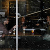 People chat in Starbucks while snow blows by outside on Monday, Oct. 9, 2017. <br /> <br /> (The Gazette, Nadav Soroker)