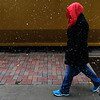 A woman walks through snow in downtown Colorado Springs, Colo. on Monday, Oct. 9, 2017. The first snow of the season in town barely made it to the ground before melting.<br /> <br /> (The Gazette, Nadav Soroker)