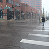 A man runs across Colorado Street downtown while snow drifts down, on Monday, Oct. 9, 2017. The snow petered off after noon.<br /> <br /> (The Gazette, Nadav Soroker)
