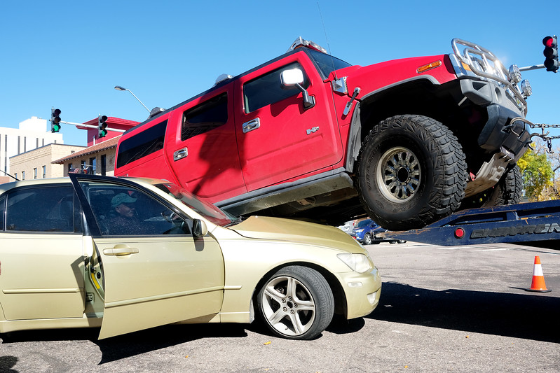 Steve Denney tries to start his car so he can drive out from under the Hummer that ran over him in the intersection of Colorado Ave. and Weber St. on Tuesday, Oct. 10, 2017.<br /> <br /> (The Gazette, Nadav Soroker)