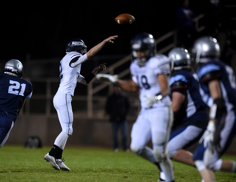 Air Academy quarterback Bo Powers throws a pass at Widefield's CA Foster stadium on Friday, Oct. 13, 2017. Widefield won 28-24.<br /> <br /> (The Gazette, Nadav Soroker)