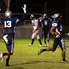 Widefield junior Luis Maldonado scores a touchdown as his teammate Rodrick Jones throws up his hands at Widefield's CA Foster stadium on Friday, Oct. 13, 2017. Widefield won 28-24.<br /> <br /> (The Gazette, Nadav Soroker)