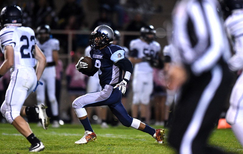 Widefield senior Joquez Addison runs with the ball at Widefield on Friday, Oct. 13, 2017. Widefield won 28-24.<br /> <br /> (The Gazette, Nadav Soroker)
