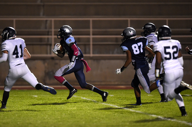 Widefield quarterback Tj Davis runs in a touchdown at the start of a game against Air Academy at CA Foster stadium on Friday, Oct. 13, 2017. Widefield leads 13-7 at half-time.<br /> <br /> (The Gazette, Nadav Soroker)