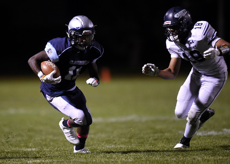 Widefield senior Myreik Goodwin runs past Kadet Rylee Ollivierre at Widefield on Friday, Oct. 13, 2017. Widefield won 28-24.<br /> <br /> (The Gazette, Nadav Soroker)