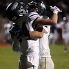 Air Academy junior Michael Midkiff, left, cheers with Troyer Morse after Morse scored a touchdown at Widefield's CA Foster stadium on Friday, Oct. 13, 2017. Widefield won 28-24.<br /> <br /> (The Gazette, Nadav Soroker)