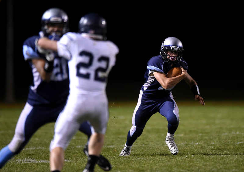 Widefield junior Frankie Ingraldi runs while his teammate John Underwood blocks for him at Widefield on Friday, Oct. 13, 2017. Widefield won 28-24.<br /> <br /> (The Gazette, Nadav Soroker)