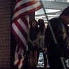 Maree Elmore watches as members of the American Legion and Colorado Patriot Guard Riders file past American flags during a memorial for her boyfriend, Chris Roybal, in Colorado Springs, Colo. on Sunday, Oct. 15, 2017. Roybal, a general manager of Crunch Fitness in Colorado Springs, was a victim of the Las Vegas massacre.<br /> <br /> <br /> (The Gazette, Nadav Soroker)