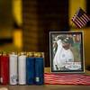 A photo of Chris Roybal is displayed near candles outside of Crunch Fitness in Colorado Springs, Colo. on Sunday, Oct. 15, 2017. Roybal was a victim of the Las Vegas shooting and a memorial was held for him outside the gym he managed.<br /> <br /> (The Gazette, Nadav Soroker)