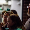 Donna Nissl watches while friends of Chris Roybal speak at his memorial outside Crunch Fitness in Colorado Springs, Colo. on Sunday, Oct. 15, 2017. Nissl, a member of the gym, remembered a boisterous and joking friendship with Roybal.<br /> <br /> <br /> (The Gazette, Nadav Soroker)