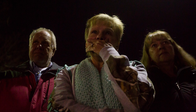 "James Hill, left, Kathleen Reynolds and Peggy Hill, members of Crunch Fitness, watch a memorial for Chris Roybal, a general manager at the gym and victim of the Las Vegas shooting, in Colorado Springs, Colo. on Sunday, Oct. 15, 2017. ""Not many people go out of their way to make you feel special,"" Kathleen said. ""But thats what he did.""<br /> <br /> <br /> (The Gazette, Nadav Soroker)"