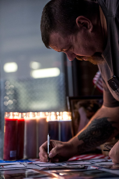 "Daniel Scott writes down a note on a board dedicated to Chris Roybal, general manager at Crunch Fitness and victim of the Las Vegas shooting, in Colorado Springs, Colo. on Sunday, Oct. 15, 2017. Scott was a member of the gym and talked with Roybal a lot. ""He was one of the main reasons I came to the gym,"" Scott said. ""Cause he made it a friendly place to be.""<br /> <br /> <br /> (The Gazette, Nadav Soroker)"