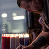 """Daniel Scott writes down a note on a board dedicated to Chris Roybal, general manager at Crunch Fitness and victim of the Las Vegas shooting, in Colorado Springs, Colo. on Sunday, Oct. 15, 2017. Scott was a member of the gym and talked with Roybal a lot. """"He was one of the main reasons I came to the gym,"""" Scott said. """"Cause he made it a friendly place to be.""""<br /> <br /> <br /> (The Gazette, Nadav Soroker)"""