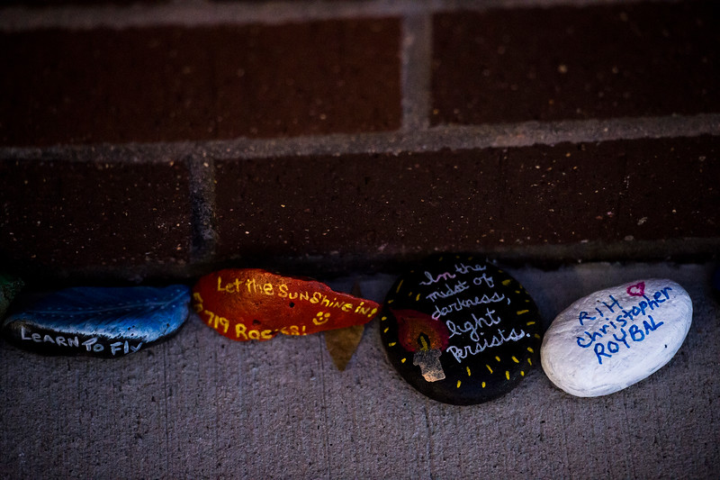 "Rocks with messages line the walls outside of Crunch Fitness in Colorado Springs, Colo. on Sunday, Oct. 15, 2017. The messages or images painted on the rocks were for Chris Roybal, general manager at the gym and victim of the Las Vegas shooting. ""Instead of flowers people have been bringing rocks."" Ginger Coleman, a gym employee, said. ""Every day when I come to work there's more.""<br /> <br /> <br /> (The Gazette, Nadav Soroker)"