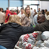Andrew Wynn, right, bumps elbows to say hello so that he keeps his gloves clean while giving away food at Pikes Peak Community College in Colorado Springs, Colo. on Monday, Oct. 16, 2017. Wynn, a facilities employee at the college, helped set up everything for the event, gave away acorn squash, and then got ready to tear it all down at the end.<br /> <br /> (The Gazette, Nadav Soroker)