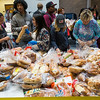 Volunteers hand out bread at Pikes Peak Community College in Colorado Springs, Colo. on Monday, Oct. 16, 2017.<br /> <br /> <br /> (The Gazette, Nadav Soroker)