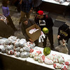 People grab bags of food at Pikes Peak Community College in Colorado Springs, Colo. on Monday, Oct. 16, 2017. Care and Share partnered with organizers from the school to give away over 11,000 pounds of food.<br /> <br /> <br /> (The Gazette, Nadav Soroker)