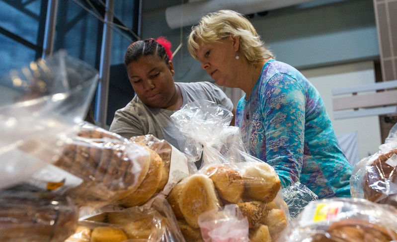 Bettie Mays, a culinary arts student, and Ruth-Ann Larish, a teacher at Pikes Peak Community College, look at the bread options they have for giving away at the college in Colorado Springs, Colo. on Monday, Oct. 16, 2017. Volunteers have away over 11,000 pounds of food in an effort to curb food insecurity in community college students.<br /> <br /> <br /> (The Gazette, Nadav Soroker)