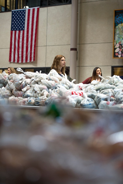 Megan Smith, a new student orientation coordinator at Pikes Peak Community College, waits to give away food in the college atrium in Colorado Springs, Colo. on Monday, Oct. 16, 2017. Volunteers gave away over 11,000 pounds of food.<br /> <br /> <br /> (The Gazette, Nadav Soroker)