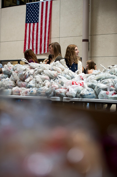 Megan Smith, a new student orientation coordinator at Pikes Peak Community College, waits to give away food in the college atrium in Colorado Springs, Colo. on Monday, Oct. 16, 2017. Volunteers gave away over 11,000 pounds of food.<br /> <br /> (The Gazette, Nadav Soroker)