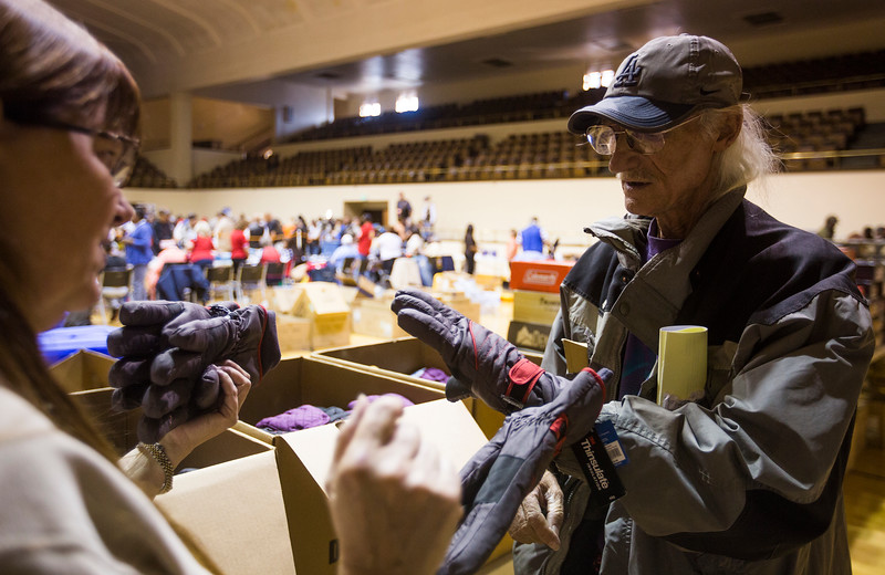 Joe Tustin tries on winter gloves at the Veterans Stand Down in the Colorado Springs City Auditorium on Tuesday, Oct. 17, 2017. The stand-down gives homeless vets access to services as well as getting them necessary items to make it through the winter.<br /> <br /> (The Gazette, Nadav Soroker)