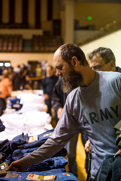David Ivey picks out jeans at the Veterans Stand Down in the Colorado Springs City Auditorium on Tuesday, Oct. 17, 2017. Backpacks, clothes, hygiene products, boots and winter gear were available for homeless veterans to help them get through the cold weather.<br /> <br /> <br /> (The Gazette, Nadav Soroker)