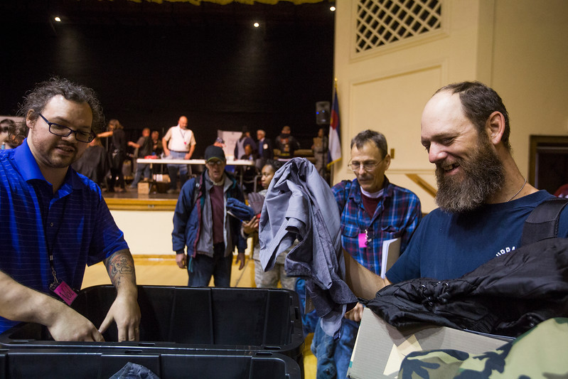 David Ivey, right, laughs while getting new winter clothes at the Veterans Stand Down in the Colorado Springs City Auditrium on Tuesday, Oct. 17, 2017. Ivey was wearing four shirts and two pairs of pants to keep warm when he arrived.<br /> <br /> <br /> (The Gazette, Nadav Soroker)