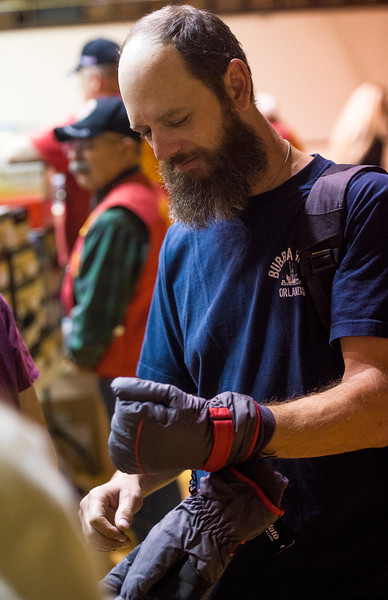 David Ivey tries on winter gloves at the Veterans Stand Down in the Colorado Springs City Auditorium on Tuesday, Oct. 17, 2017. Ivey is an artist and finished a year of Graphic Design school on the GI Bill.<br /> <br /> (The Gazette, Nadav Soroker)