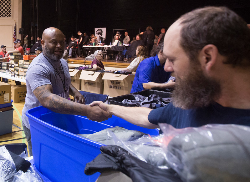 David Ivey, right, shakes hands with a volunteer who got him a warm fleece jacket at the Veterans Stand Down at the Colorado Springs City Auditorium on Tuesday, Oct. 17, 2017.<br /> <br /> <br /> (The Gazette, Nadav Soroker)