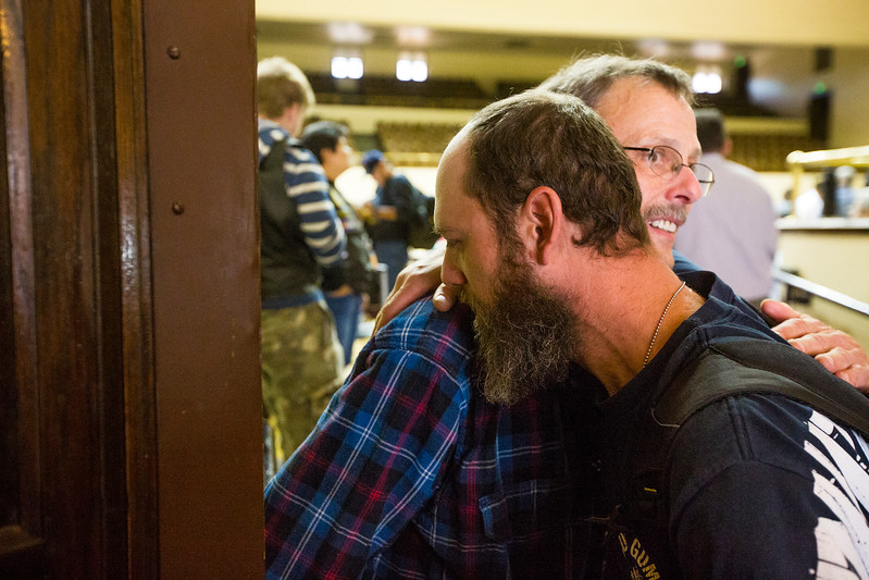 David Ivey, front, hugs Roger Stewart after the Veterans Stand Down in the Colorado Springs City Auditorium on Tuesday, Oct. 17, 2017. Stewart, who guided Ivey through he event, received help from some of the groups at the stand down when he arrived in Colorado and now  volunteers to give back.<br /> <br /> <br /> <br /> (The Gazette, Nadav Soroker)