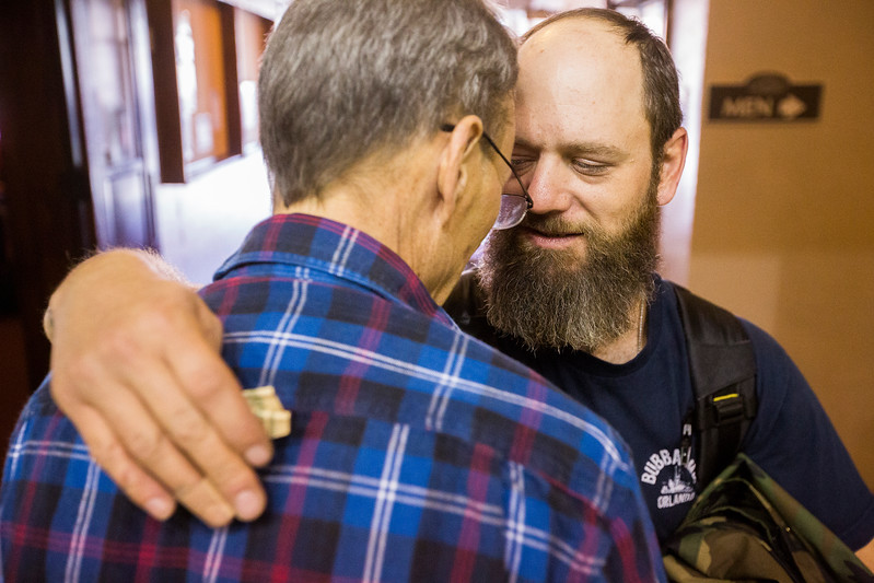 David Ivey, right, hugs his guide Roger Stewart after lunch the Veterans Stand Down in the Colorado Springs City Auditorium on Tuesday, Oct. 17, 2017. All the veterans attending the Stand Down were given an active serviceman or a volunteering veteran as a guide through the process; once they were done Stewart gave Ivey a few dollars to help out.<br /> <br /> (The Gazette, Nadav Soroker)