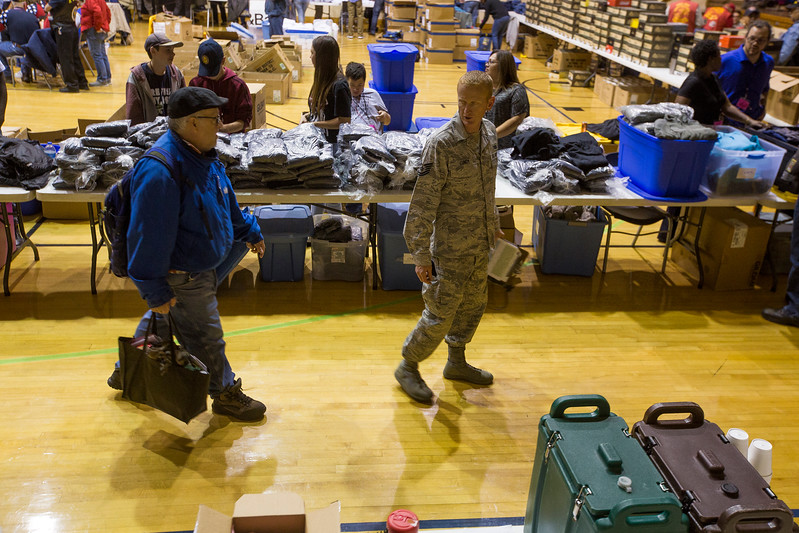 Nathan Albaugh follows Russel Lundy through the Veterans Stand Down in the Colorado Springs City Auditorium on Tuesday, Oct. 17, 2017. Lundy, an active duty serviceman at Peterson Air Force Base, was paired with Albaugh to help guide him through the densely packed maze of services and offerings.<br /> <br /> (The Gazette, Nadav Soroker)