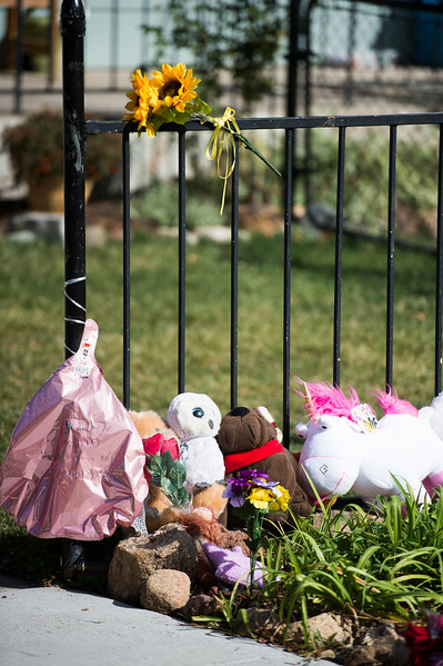 Flowers and stuffed animals lay in front of a house where two young children were found stabbed. Their older brother is in police custody as a suspect. Photographed on Thursday, Oct. 19, 2017.<br /> <br /> <br /> (The Gazette, Nadav Soroker)