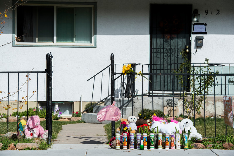 Candles, flowers and stuffed animals lay in front of a house where two young children were found stabbed. Their older brother is in police custody as a suspect. Photographed on Thursday, Oct. 19, 2017.<br /> <br /> <br /> (The Gazette, Nadav Soroker)