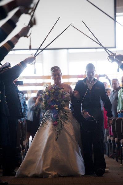 Tessa Thomas and Naval Petty Officer 3rd class Colin Thomas walk down the aisle and under raised swords after renewing their wedding vows at the New Life Church on Friday, Oct. 20, 2017. Colin suffers from stage 4 pancreatic cancer which forced him from the Navy.<br /> <br /> <br /> (The Gazette, Nadav Soroker)