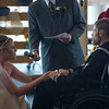 Tessa Thomas renews her wedding vows with Naval Petty Officer 3rd class Colin Thomas as his grandfather, Clyde Thomas, officiates at the New Life Church on Friday, Oct. 20, 2017. Colin suffers from stage 4 pancreatic cancer which forced him from the Navy, and prompted the couple to renew their vows.<br /> <br /> <br /> (The Gazette, Nadav Soroker)