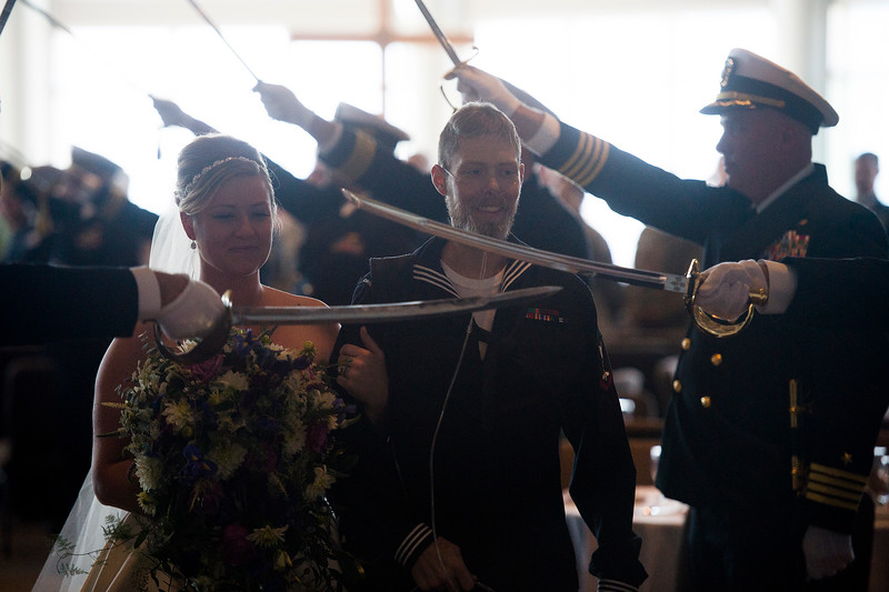 Officers raise sabres and release Tessa Thomas and Naval Petty Officer 3rd class Colin Thomas after they finished renewing their wedding vows at the New Life Church on Friday, Oct. 20, 2017. Colin suffers from stage 4 pancreatic cancer which forced him from the Navy.<br /> <br /> <br /> (The Gazette, Nadav Soroker)